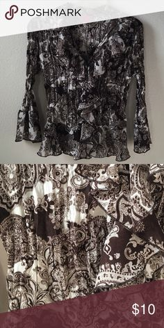 Brown & White Paisley Ruffle Top Paisley top with ruffle detailing down the V neck and button down front. Design looks black and white in photo but is actually a rich chocolate brown and white. Sleeves are a bit longer than 3/4 have a flare just at the cuff Sunny Leigh Tops Blouses