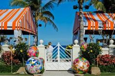 Balloons wrapped in Hermès silk scarf prints stood at the entrance to the Palm Beach event.