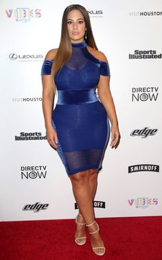 Ashley Graham in a blue off-the-shoulder mini dress