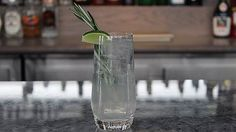 Tuscan Countryside 1.5oz. Bombay Sapphire Gin .5oz. Limoncello .5oz. Rosemary syrup  Fill a highball glass with ice and combine ingredients in order. Top with half soda, half tonic water. Stir. Garnish with a lime and sprig of fresh rosemary.