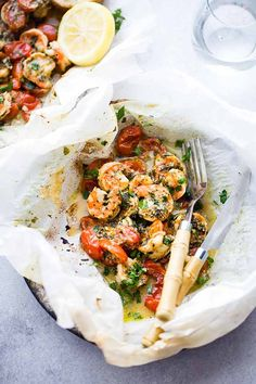 Lemon Garlic Herb Shrimp in Packets - baked shrimp recipe made with a lemon garlic herb sauce and cooked inside parchment packets!