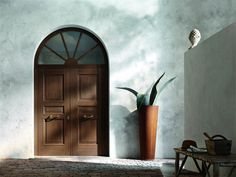 Modern door by Oikos Venezia in brushed oak. Legno Vivo line.