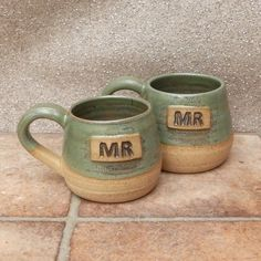 Mr and Mr cuddle mugs coffee tea cups in stoneware hand thrown ceramic pottery by Caractacus Pots on Gourmly