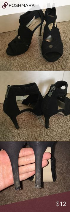 X-Appeal black high heels Worn a few times, X-Appeal black high heels, (about three inches), cut outs, with zipper back, size 6 Xappeal Shoes Heels