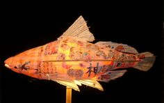 Elaine Hanowell has been making lighted sculpture for over 20 years. Fish lamps are currently available in four varieties: Bass, Perch, Koi, and Catfish. Each sculpture is made from handmade paper and collage elements gathered from around the world. The lamp bases, available in floor or table lengths, are handmade from bamboo, slate, and linen thread. All lighted fish (table, floor, and sconce) are $750 each. Shipping is available. Contact ArtXchange Gallery at 206-839-0377 for information.