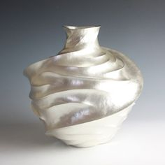 Incredible hammer-raised and chased silver vessels by Hiroshi Suzuki.
