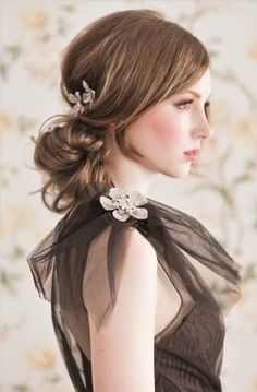 What a cute rendition of a ponytail that looks adorable and formal without making it to elegant.