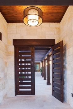 Modern Texas Hill Country Ranch Design Ideas, Pictures, Remodel and Decor- the color scheme with cherry wood and austin limestone Hill Country Homes, Texas Hill Country, Door Design, Exterior Design, House Design, Custom Home Designs, Custom Homes, Texas Homes, New Homes