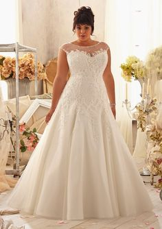 Top 10 Plus Size Wedding Dress Designers By Pretty Pear Bride #plussize #bride | Gown by Mori Lee.. I know I'm not getting married since I just did, but I'm in love with this dress!