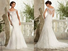 A dramatic illusion back edged in delicate Alencon lace, takes center stage on this gorgeous fit and flare wedding dress. Scalloped lace accents the bateau neckline and hem. Covered button detail finishes the back. Available in White, Ivory