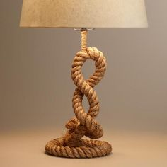 Crafted of woven jute rope, our exclusive, nautical-inspired pedestal lamp gives any room the warm, laid-back feel of the beach house. Complete its unique style with any of our table lamp shades.