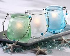 USE ASHLEY GREEN CANDLE & FROST IT.....seaglass candles
