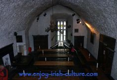 Bunratty Castle, County Clare, Ireland- the vaulted hall, now used as banquetting hall for medieval banquets. Click on the photo to read our article on the fascinating 800 year history of the castle.
