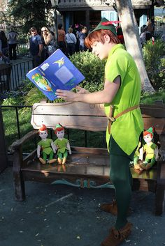 "Peter reading ""Peter Pan"" to the Peter Pans ~ The book's upside down...Hilarious! Gotta love Peter  Lol!"