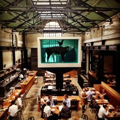 Tramshed in Shoreditch: Chicken or steak, that's the question that awaits one at Mark Hix's Tramshed. The über cool eatery serves only whole roast chicken or  steak – both with a side of fat chips and salad. That's it.  Diners eat under the watchful eyes of a massive Damien Hirst artwork – a tank featuring a cow and a chicken, eternalized forever in a bath of formaldehyde. http://www.chickenandsteak.co.uk/
