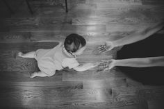 A documentary photograph of baby crawling to his mother during their lifestyle family photo session in Jamaica Plain - Boston, Massachusetts - Gina Brocker Photography