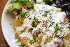 Chilaquiles ~ Mexican chilaquiles, strips of fried corn tortillas simmered in salsa, and served with cheese, eggs, or beans. ~ SimplyRecipes.com