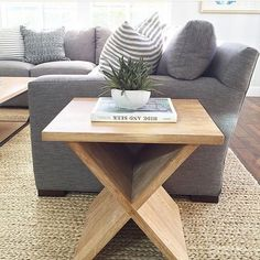 Side Table For Living Room. gray linen couch  natural wood side table and fiber rug M s Down To Basics Decorating With Cube Furniture Zig zag