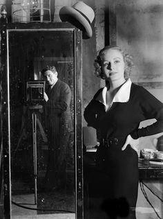 Spencer Tracy taking a photo of Madge Evans, 1934, on the set of The Show-Off