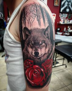 Wolf and roses on first timer. Done by Tyler Turnbull. Artistic Impressions Tattoo. Katy TX.