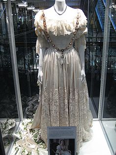 A re-creation of Queen Victoria's wedding dress used in filming the 2009 movie, The Young Victoria. A British-American period drama film directed by Jean-Marc Vallée and written by Julian Fellowes, based on the early life and reign of Queen Victoria, and her marriage to her cousin, Prince Albert of Saxe-Coburg and Gotha.