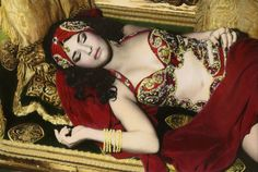 Youssef Nabil - Photographer  > Natacha Atlas Sleeping, Cairo 2000  > Youssef Nabil was born in Cairo. He lives and works in New York City. According to his biography, he grew up in Cairo drenched in the cinema of the 'golden age of Hollywood on the Nile'. He recalls with nostalgia the glamour, ease, elegance, and melodrama of that world in black and white. He captures his images in grayscale and manually colorizes. Loving the effect!
