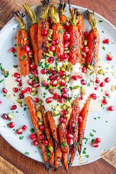 Maple Roasted Carrots In Tahini Sauce With Pomegranate
