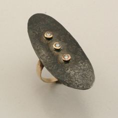 Jim Cotter: Shield Ring  14 Karat Yellow Gold and Steel with Diamonds
