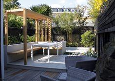 Slatted pergola over built in garden seating