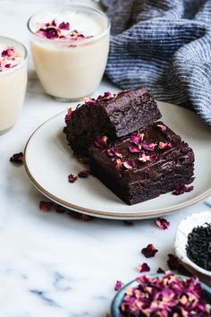 Frosted earl grey brownies baked in a loaf pan and topped with rose petals