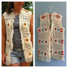 "1960s vintage crochet boho fringed vest authentic vintage! beautiful vintage crochet yarn vest. no label or tags, bold tribal geometric design in yellow, blue, and red yarn. yarn appears to be worsted, a mix, cotton/wool or cotton/acrylic. yarn fringe around collar and edges. best fit size xs/s.   condition - excellent  measurements - taken with the garment laying flat -  bust - 17 1/4"" hips - 18"" shoulders - 13 1/2"" length - collar to yarn edge hem - 29"" sleeve opening - 10"" around Vintage…"