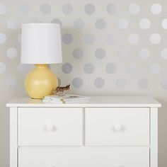 Wall decals I can actually get excited about.  These silver dots turn an ordinary wall into fun, fancy wallpaper!  From the Land of Nod.