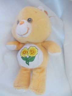 """9"""" Peach PLUSH """"FRIEND"""" CARE BEAR, 2 flowers on her and a heart on each foot #Carebear#Friend#AllOccasion"""