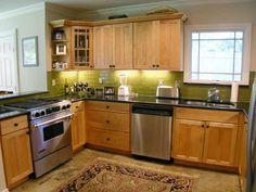 kitchen backsplash subway tile black granite countertop | the glass subway tiles are from emser tile billiard green