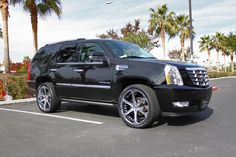 07 Escalade (or EXT) on 24s, Black on Black, with power step, 4x4