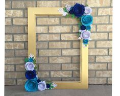 Your event deserves unforgettable photographs, and this fine art photo frame is the way to make that happen. I handcraft this frame from scratch and will make it in your event colors. It is a physical product and a work of art! This frame features a double layered beveled glitter gold background. Each rose is handmade and completely unique. The roses are aqua, royal blue, and white. They are gorgeously surrounded by leaves in shades of green, emerald, hunter green and white.  How to order…