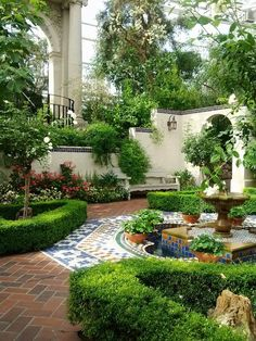 Love this Moroccan courtyard with tiled and paved areas, walled gardens, water feature.