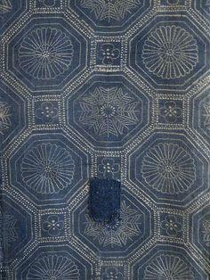 Detail view, antique indigo-dyed cotton katazome cloth with patches   SIRI Threads.