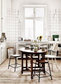 Rustic dining space in country kitchen with sunflower