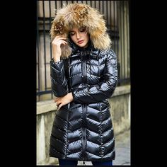 This is an awesome picture of this girl in her very sexy looking puffy jacket. #puffyjacket #shiny #puffy #nylon #puffer #black #down #jacket #doudoune #fur #furhood #love #beautiful #girl #winter #fashion