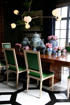 Black & white floor wood table white chairs green upholstery mod glam ceiling fixture