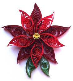 basteln-papierstreifen-quilling-weihnachtstern-blute-anregung-rot-grün
