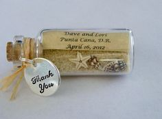 LOVE this idea! Mini Message in a Bottle Beach Wedding Favor with the bride and groom's name, the venue location and the wedding date.