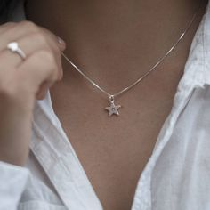 Our 'Tiny Star Initial' Necklace includes a Sterling silver hand stamped star pendant. Hanging from a choice of a 16 or 18 inch chain, the pendant is engraved with an initial. Complete in personalised grey gift box, engraved with your message. Star Necklace, Initial Necklace, Tiny Star, Star Pendant, Pearl Grey, Silver Stars, Personalized Jewelry, Sterling Silver Necklaces, Initials