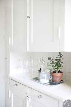 white kitchen with wine glasses on the counter
