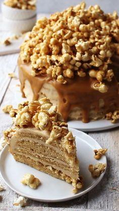 This Salted Caramel Popcorn Cake is a delicious combination of salted caramel, salted caramel frosting, caramel vanilla cake, and salted caramel popcorn. #popcorn #dessert #baking #sweet #cake