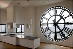 Wow.. to live in a space like this!! #clock #penthouse #kitchen #oversized