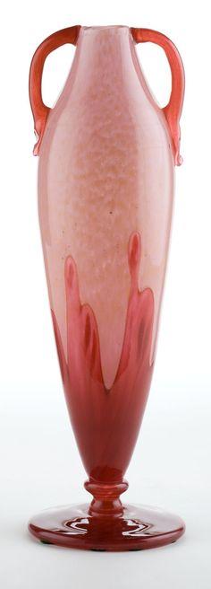 CHARLES SCHNEIDER POWDERED GLASS VASE WITH APPLIED  HANDLES  The pink powdered glass vase with trailing red overlay to lower  half, applied red handles, circa 1923  Stenciled: SCHNEIDER  13-1/2 inches high (34.3 cm)