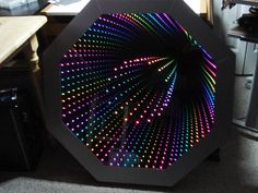 octagon infinity mirror-Contains 80 RGB LEDs, 64 on the outside and 16 on the inside. The back mirror is mirrored acrylic, with 5mm holes drilled to hold the inner ring of LEDs.