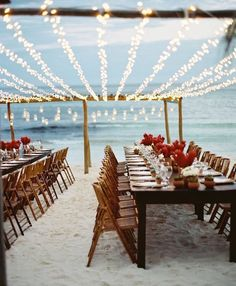 Beach wedding inspiration! This is a gorgeous setup in Mexico, with fairy lights and long tables right in the sand. 🐚 #beachbride #weddingstyling #destinationwedding #beachwedding #outdoorwedding #weddingstyle #weddingplanning #weddingideas #weddingdecor #weddingreception #weddinginspo #weddingday #weddingphoto #tablescape #tablesetting #tablestyling #engaged #bridal #bride #bridetobe #dreamwedding #fairylights #beachfront #engaged #bythewater #waterfront